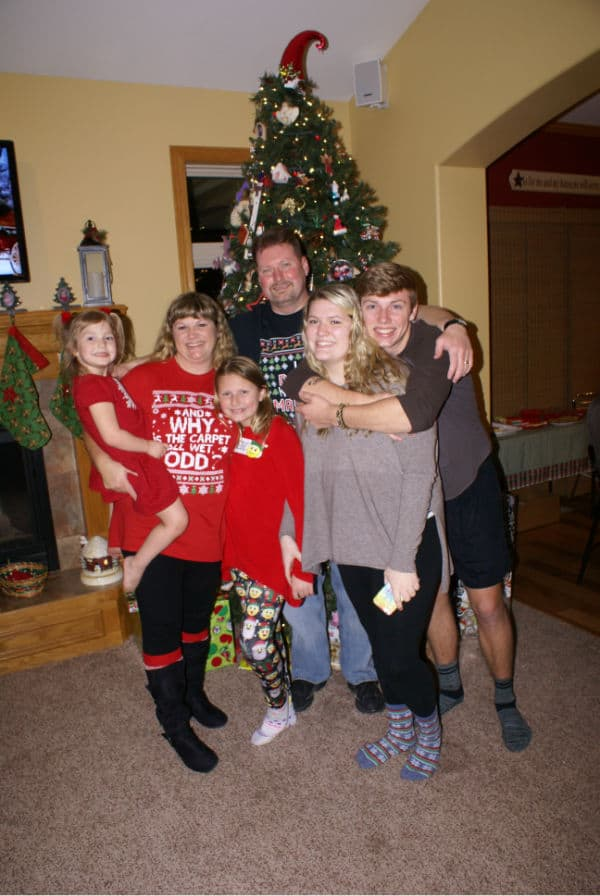family picture in front of Christmas tree