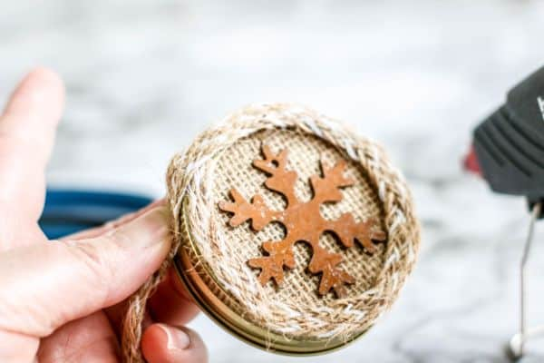 adding decorative trim to a DIY Rustic Burlap Christmas Ornaments