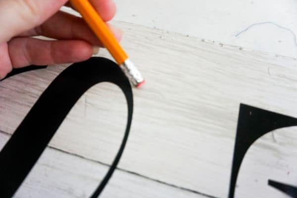 how to erase the lines off a DIY Tis the Season Porch Leaner Sign