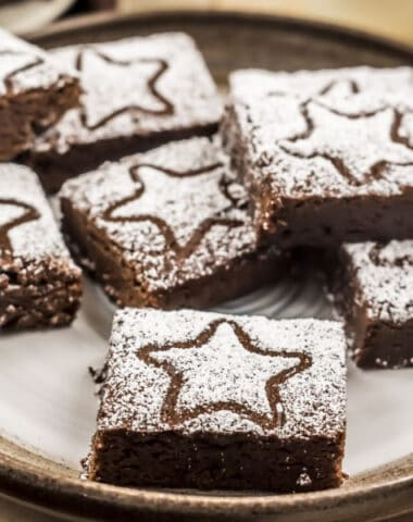 gingerbread brownies with powdered sugar decorations
