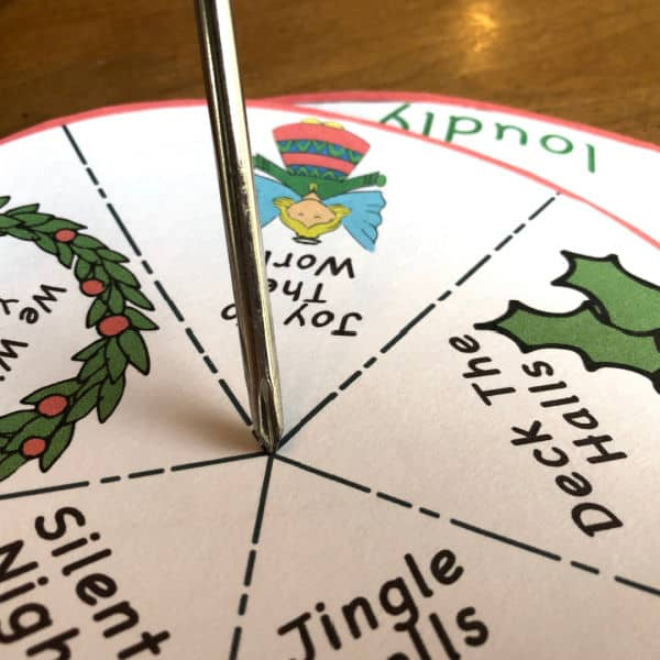 how to combine the Printable Christmas Song Spinner Game