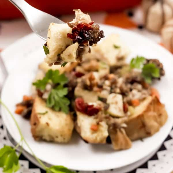 taking a bite of Easy Cranberry Sausage Stuffing