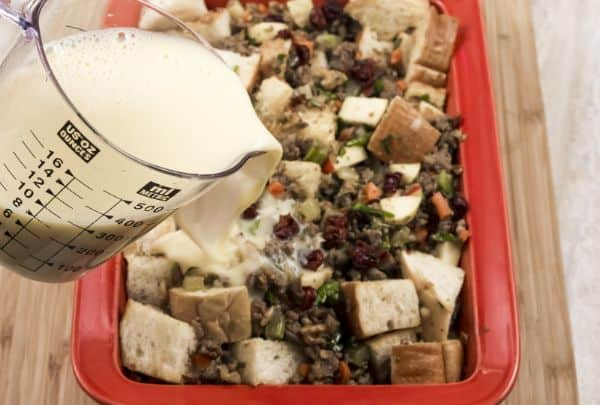 adding liquid to Easy Cranberry Sausage Stuffing