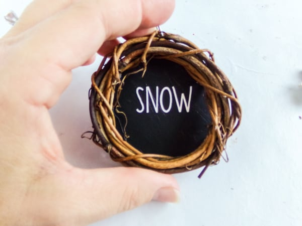 attaching cardboard circle to wreath ornament