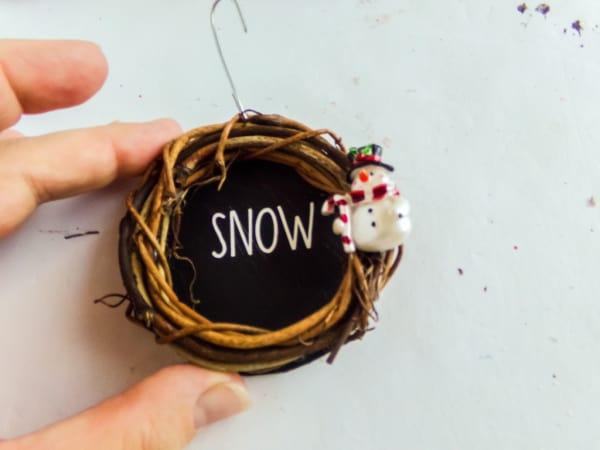 adding embellishments to ornament