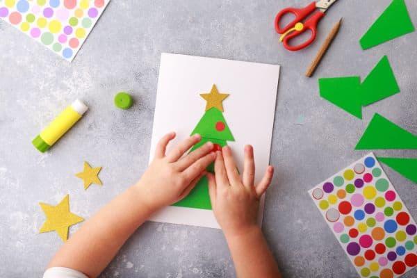Christmas activities for preschoolers doing paper crafts