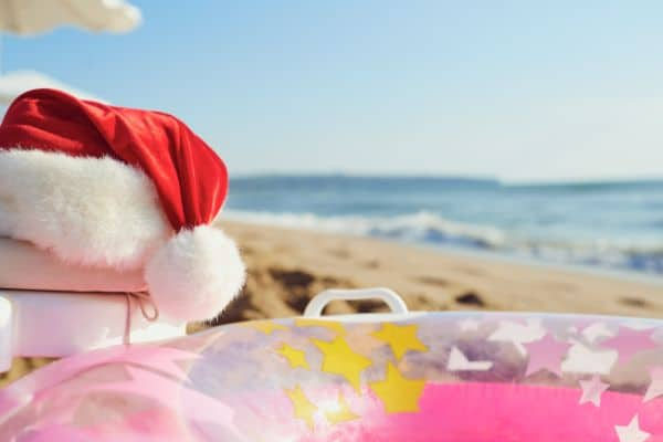 Christmas in July Santa hat on a beach