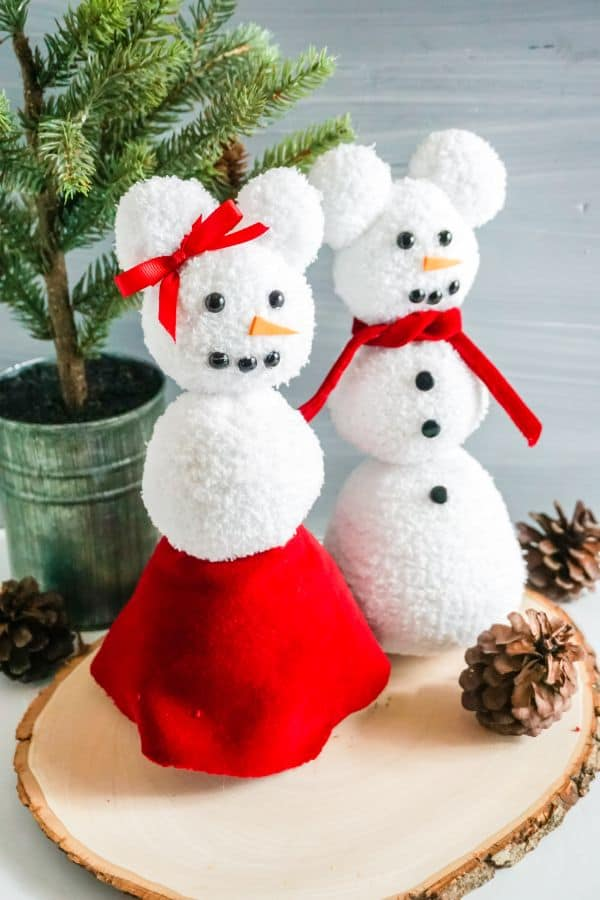 Mickey and Minnie Sock Snowmen on a table