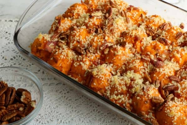 twice baked sweet potato casserole with bacon in baking dish