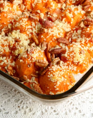 close up photo of twice baked sweet potato casserole with bacon in baking dish